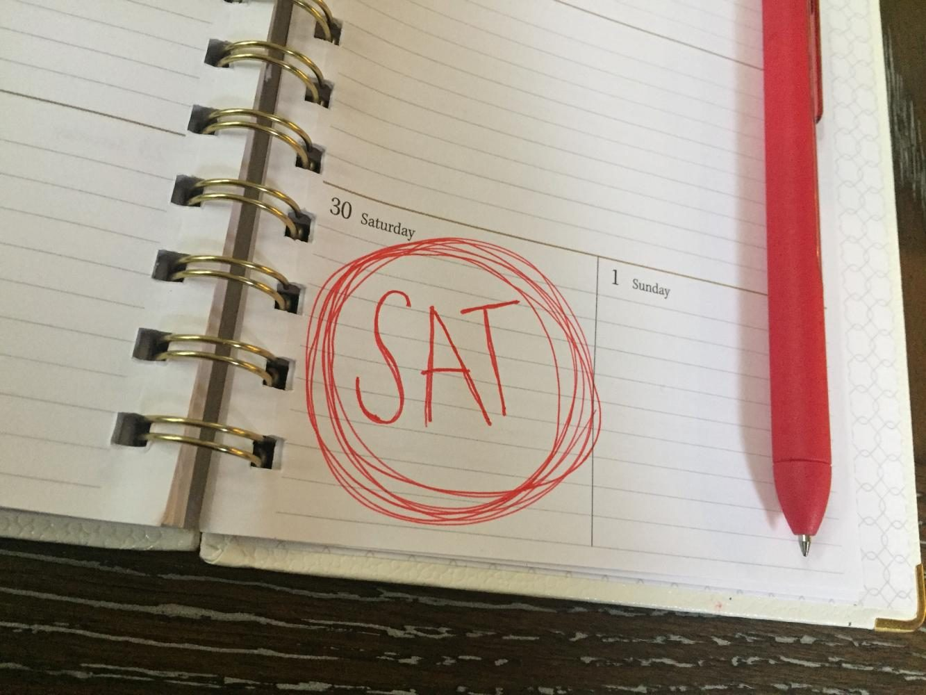 SAT written in red ink on a calendar that says Saturday 30