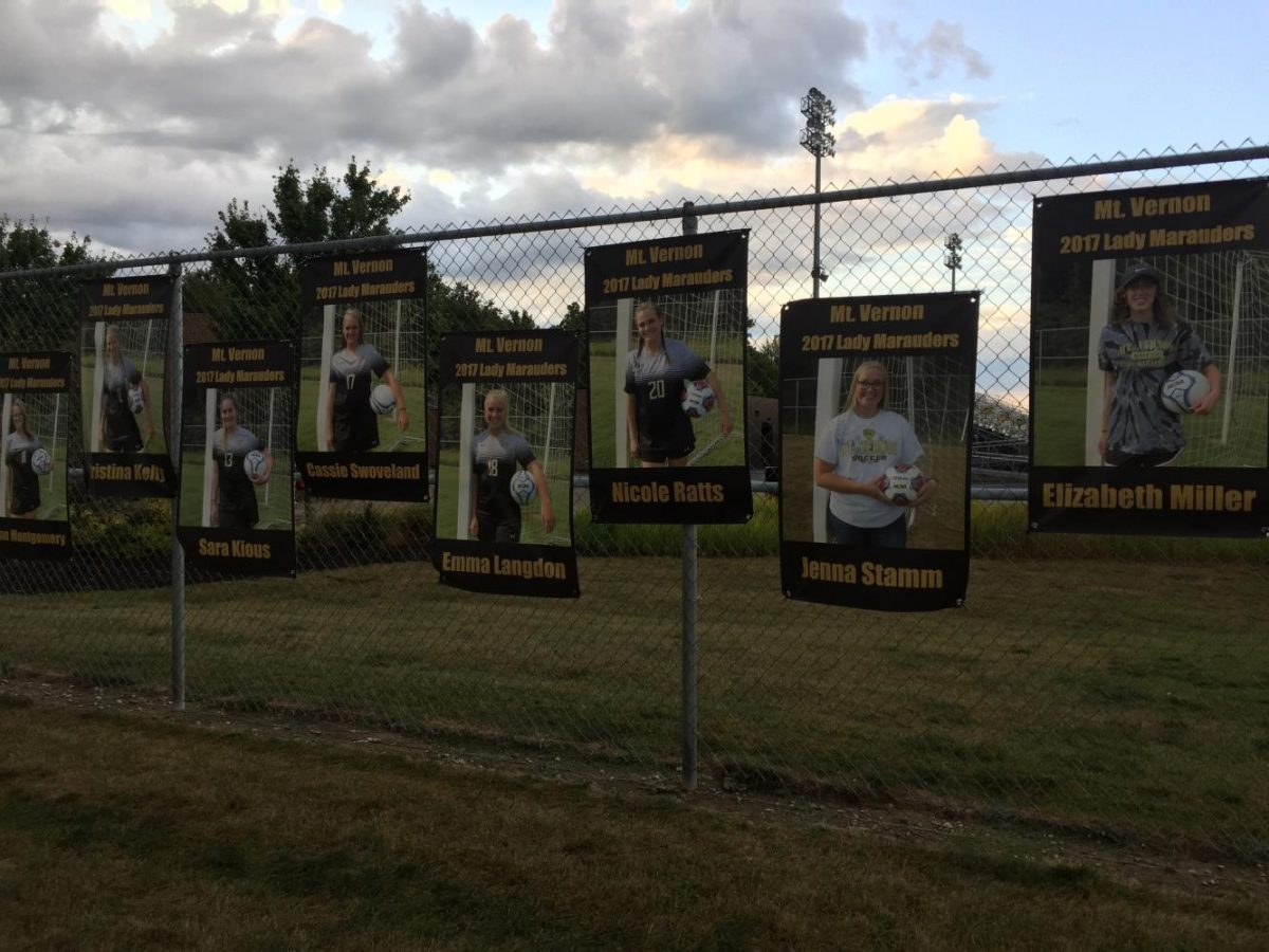 the posters of the soccer players, with Nicole Ratts in the middle