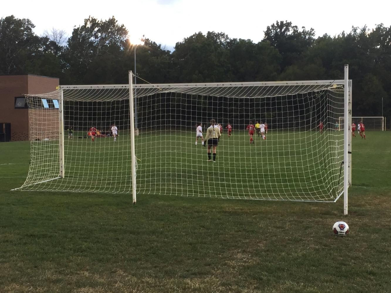 Photo of girls' soccer team practicing on the field