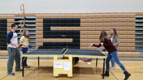 Students in the middle of a ping-pong match