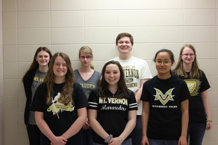 7 students stand in their MV shirts, smiling.