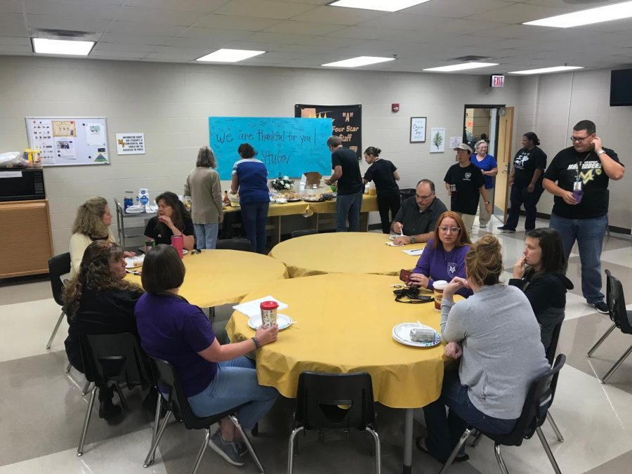 Teachers enjoy the breakfast foods provided by student government on Friday 9/21
