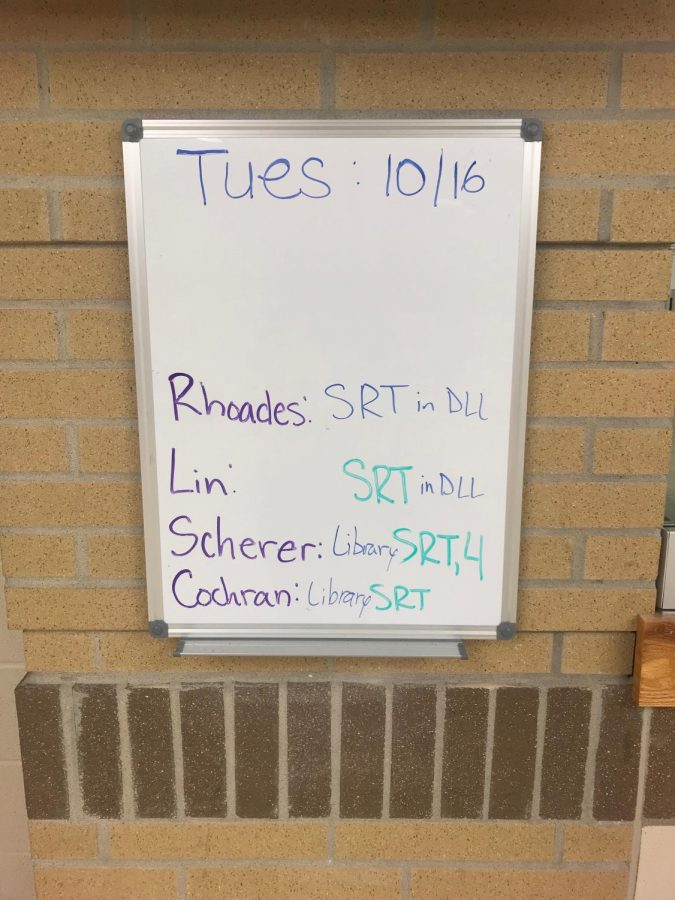 The DLL whiteboard directs students where their classes will be