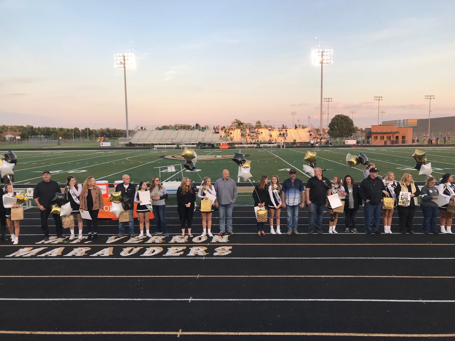 The football cheer seniors were presented with balloons