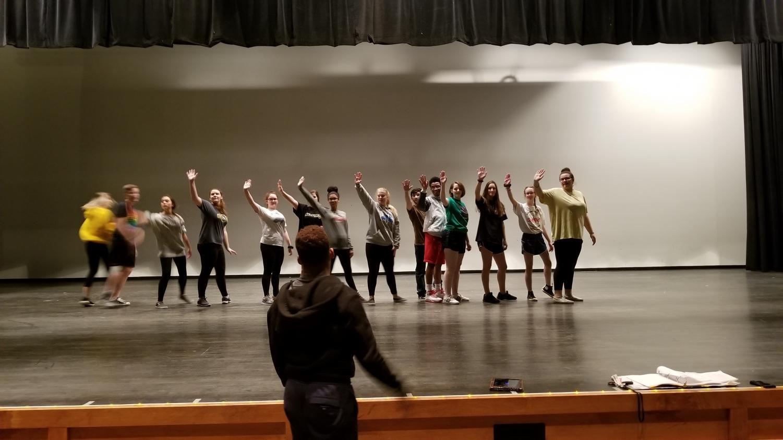 Cast dancing onstage