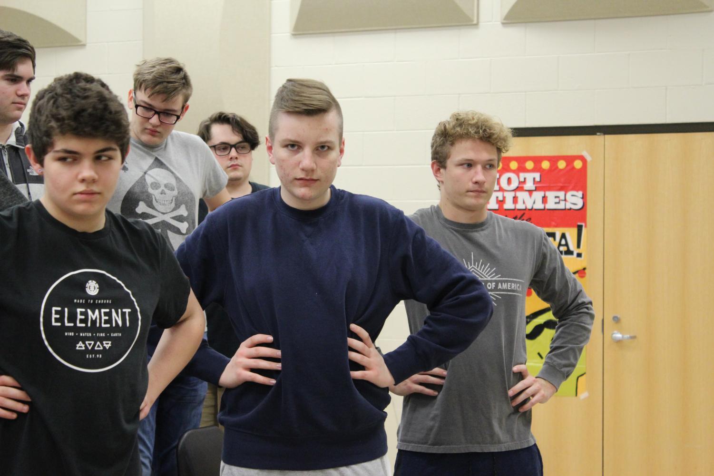Dustin Meek (9), Liam Bass (10) and Kyran Maxfield (9) warming up