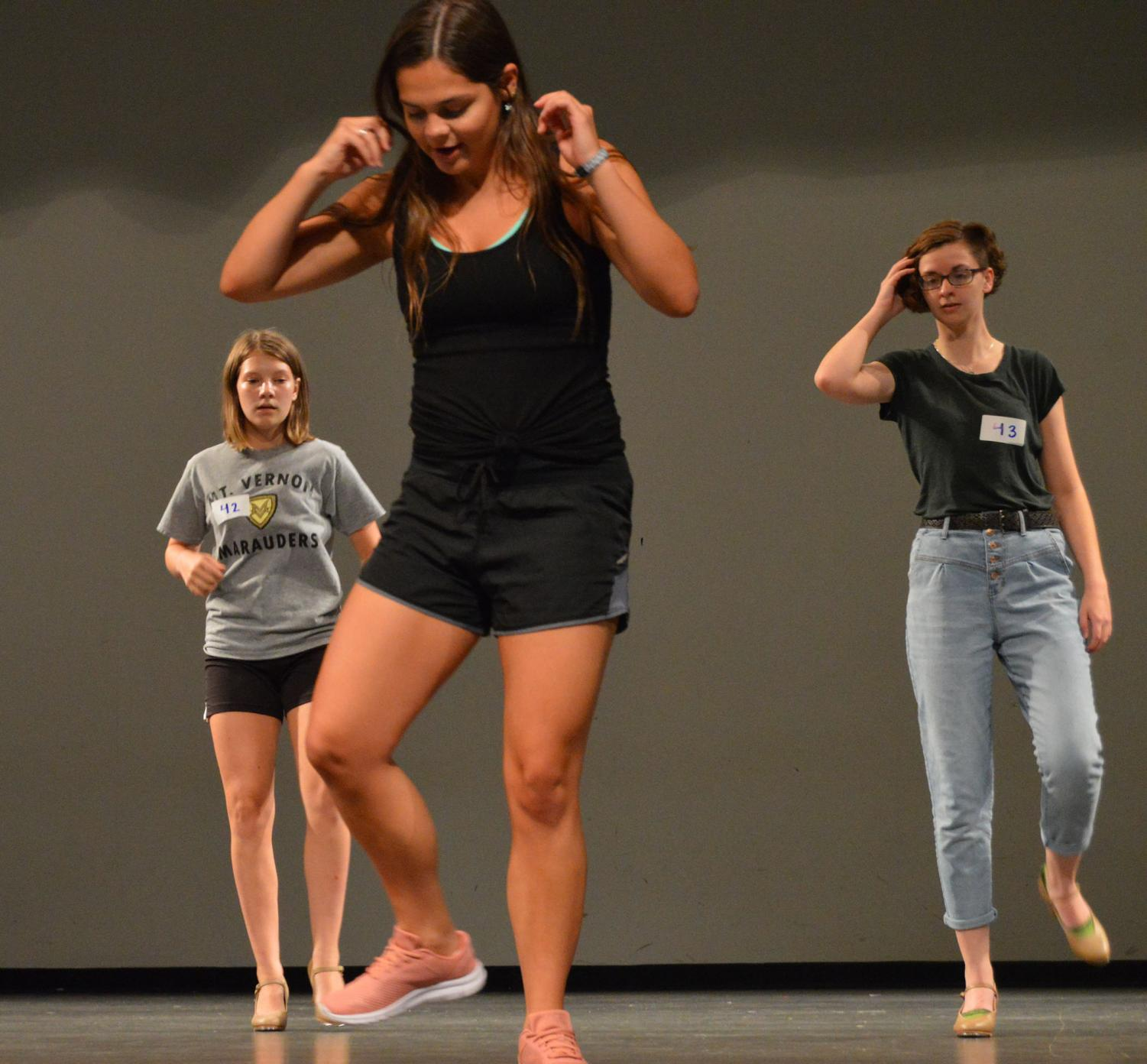 Former student Emily Thomas showing Gabby Bruce and Natalie Marshal the tap dance