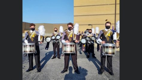 Senior Daniel Woods plays the drums during marching band season