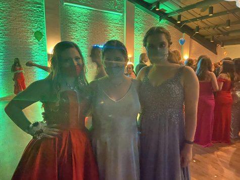Ashley Wyman (11), Katelynn Hexamer (11), and Anna Starken (11) having fun at prom.