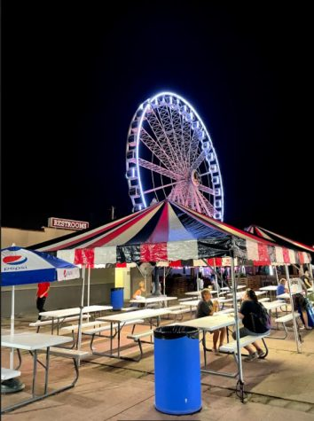 The ferris wheel lights up the night.