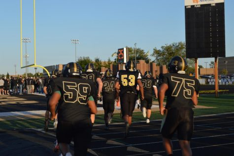 Mt. Vernon football team running out onto the field to start the game